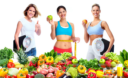 weigher: Woman with scales fruits and vegetables background