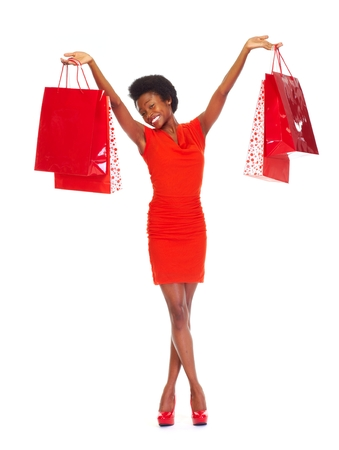 boxing day sale: African girl with shopping bags  isolated white background Stock Photo