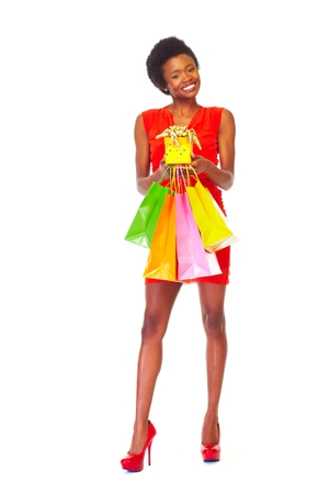 African girl with shopping bags  isolated white background photo