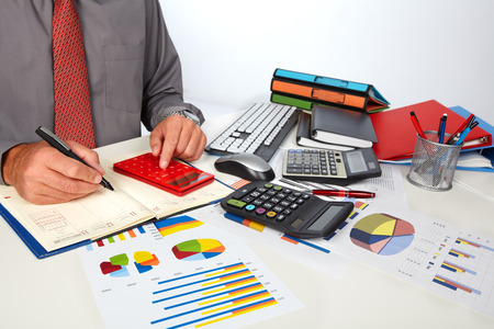 the bookkeeper: Hands of accountant business man with calculator. Accounting