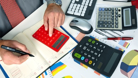 accountancy: Hands of accountant business man with calculator. Accounting