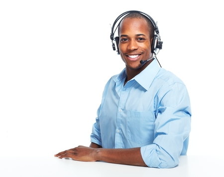 Call center operator man with headsets working.