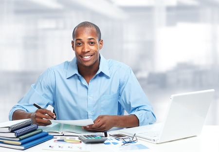 the bookkeeper: African-American black businessman in office.