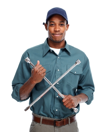 afro man: Car Mechanic with wrench Stock Photo