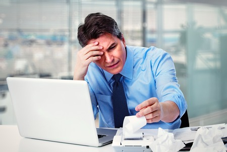 headache: Accountant businessman having a stress