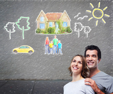 Couple thinking about new home and car. photo