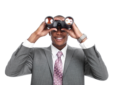 competitors: African-American businessman with binoculars  isolated white background.