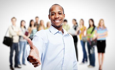 stretta di mano: Gli uomini d'affari e lavoratori del gruppo. Gruppo di Lavoro.