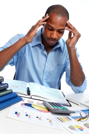 disillusionment: African-American businessman having stress.