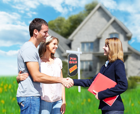 real estate investment: Family near new house.