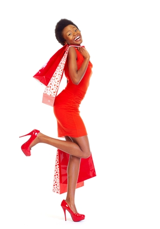 boxing day sale: African girl with shopping bags. Stock Photo