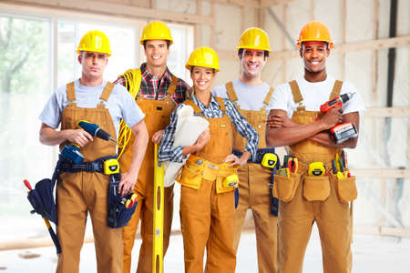 construction helmet: Group of construction workers.