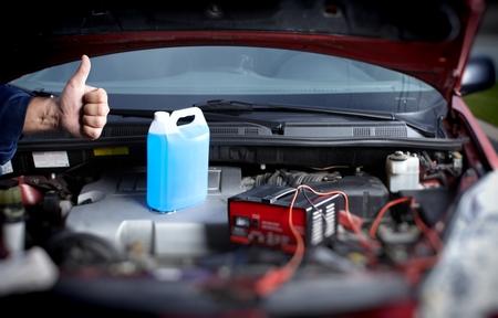 work station: Mechanic working in auto repair garage Stock Photo