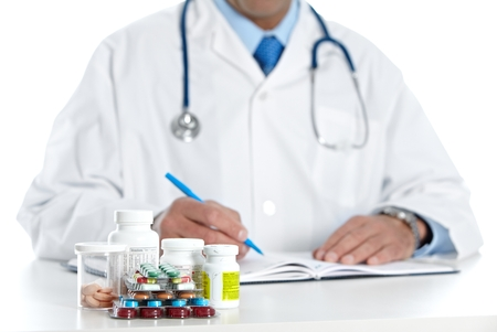 doctor writing: Doctor writing medical prescription.