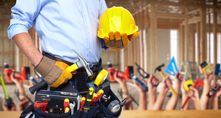 Construction worker with hammer and tools. photo