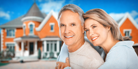 Realtor: Senior Couple near new house.