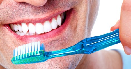 smile close up: Teeth with toothbrush. Stock Photo