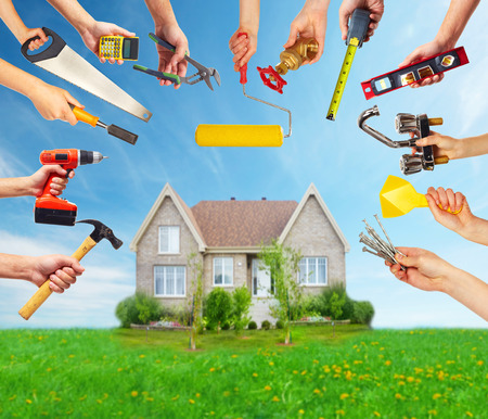building contractor: Hands with construction tools.