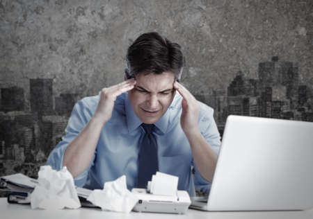 headache pain: Man having migraine headache. Stock Photo