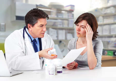 analgesics: Doctor and patient woman. Stock Photo