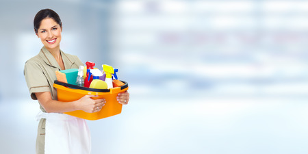 cleaning background: Young smiling cleaner woman. Stock Photo