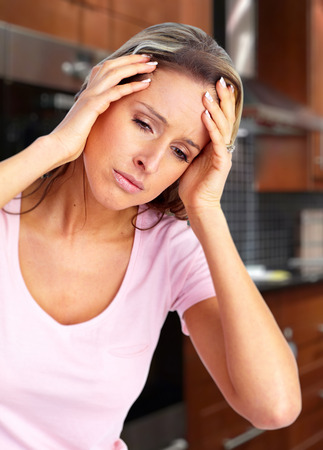 neurological: Woman having migraine headache.