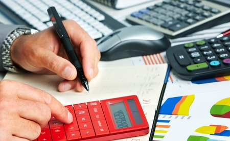 bookkeeping: Hands of accountant man Stock Photo