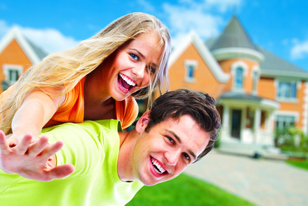 Realtor: Couple near new house. Stock Photo