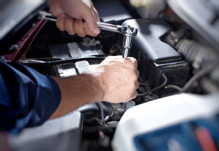 automotive repair: Mechanic working in auto repair garage Stock Photo