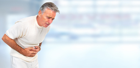 human stomach: Man having a stomach ache