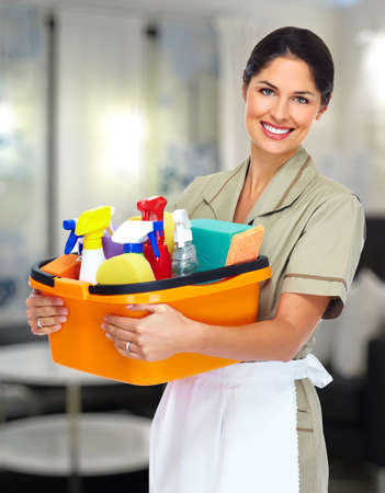 cleaning service: Young smiling cleaner woman. Stock Photo