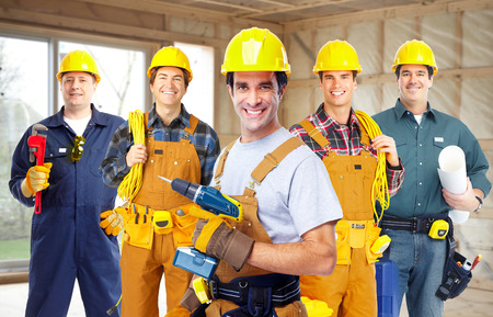 plumbing: Group of construction workers.