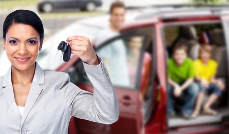 Woman holding car key. photo