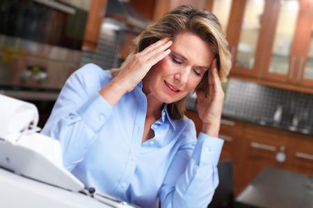 hypotension: Woman having headache migraine.
