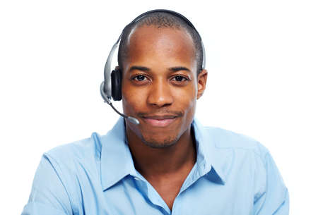 to phone calls: Call center operator man. Stock Photo
