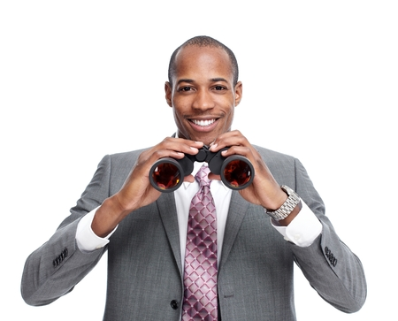 competitors: African-American businessman with binoculars. Stock Photo