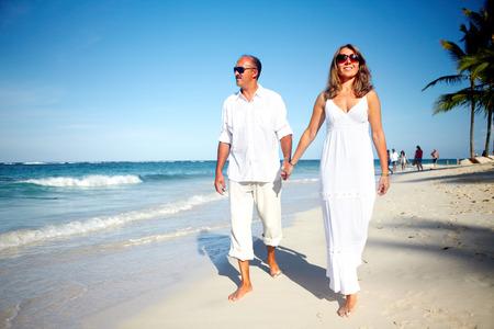 breeze: Couple walking on the beach Stock Photo