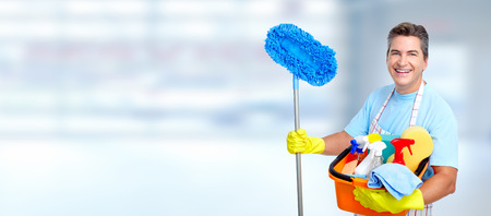 cleaning background: Man cleaner. Stock Photo