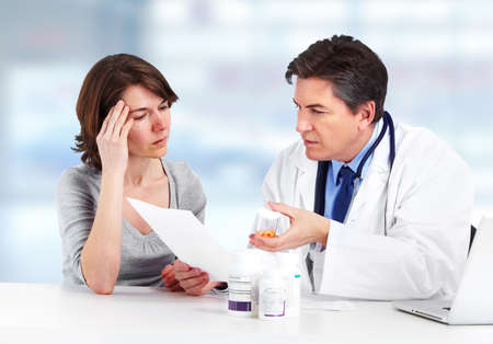 headache pain: Doctor and patient woman. Stock Photo