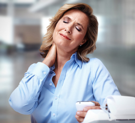 headache pain: Business woman having a neck pain