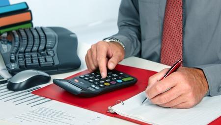 accountancy: Hands of accountant man Stock Photo