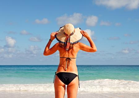 body care: Young Woman in bikini on the beach. Stock Photo