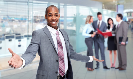 bank interior: African-American man and business team. Stock Photo