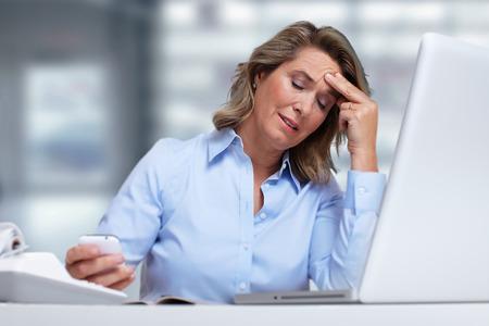 hypotension: Woman having migraine headache.