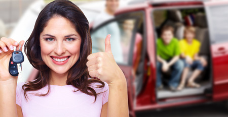 rental: Woman holding car key.