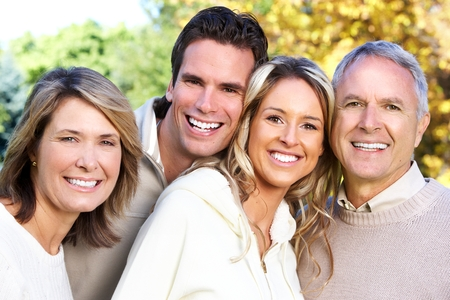 dental background: Happy family in the park. Stock Photo