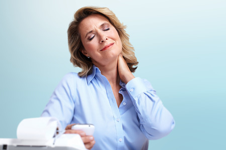 hypotension: Business woman having a neck pain