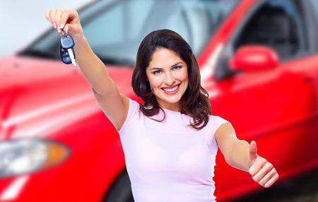 thumb keys: Woman holding car key.