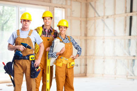 staff team: Group of construction workers.