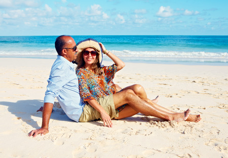 Loving couple relaxing on beach photo